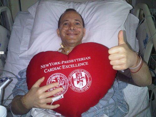 Heart Surgery Patient In Hospital With Big Red Pillow