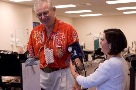 Oldler Man On Treadmill Doing Cardiac Rehab