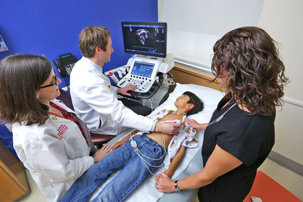 Child Having Echocardiogram with Doctor