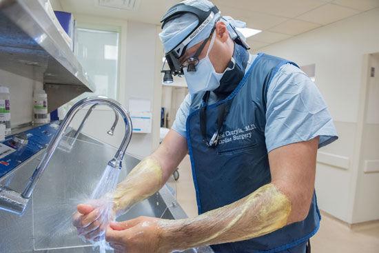 Dr. Andrei Churyla Scrubbing In For Heart Surgery