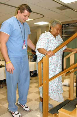 Patient Practices Going Up Stairs In Rehabilitation Class