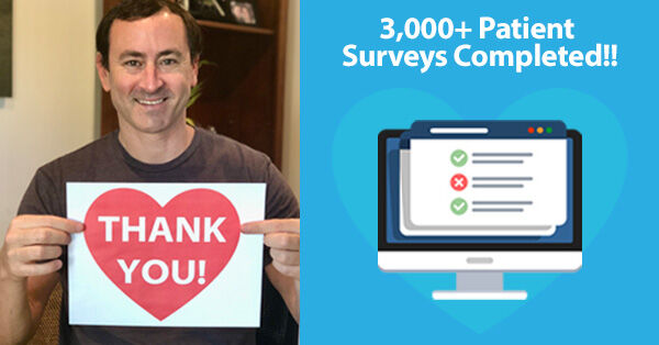 Adam Pick Holding Thank You Sign for Patient Survey Completion